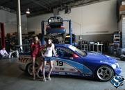 sexy models tara and amanda with the chevrolet corvette and bmw race car-474717