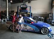 sexy models tara and amanda with the chevrolet corvette and bmw race car-474718